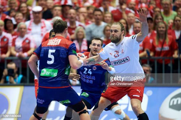 Henrik Mollgaard of Denmark defend during the IHF Men's World Championships Handball Final between Denmark and Norway in Jyske Bank Boxen on January...