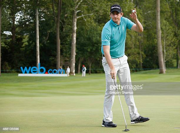 Henrik Norlander of Sweden waves to fans after finishing his round on the 18th green during the final round of the Webcom Tour Hotel Fitness...