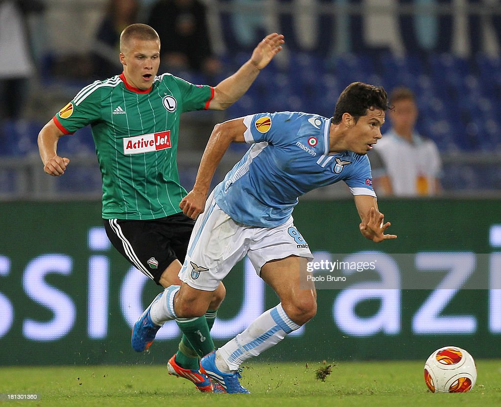 Henrik Ojamaa (L) of Legia Warszawa competes for the ball with Hernanes of SS lazio during the Uefa Europa League Group J match between SS Lazio and Legia Warszawa at Stadio Olimpico on September 19, 2013 in Rome, Italy.
