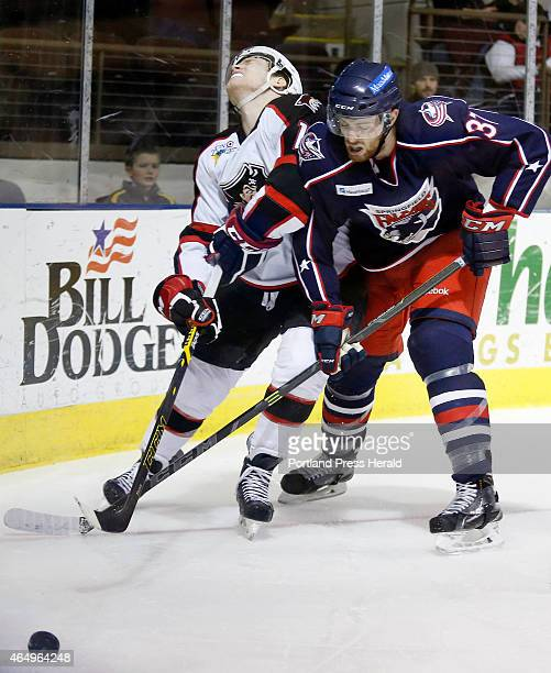 Henrik Samuelsson of Portland left and Thomas Larkin of Springfield battle for the puck during the third period
