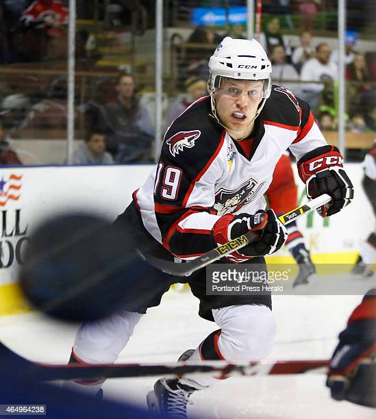Henrik Samuelsson of Portland races after the puck as it flies up the boards during the third period of their game against Springfield