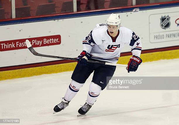 Henrik Samuelsson of Team USA skates against Team Finland during the 2013 USA Hockey Junior Evaluation Camp at the Lake Placid Olympic Center on...
