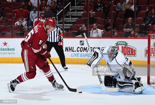 Henrik Samuelsson of the Arizona Coyotes scores a shootout goal past goaltender Peter Bartosak of the Los Angeles Kings during the preseason NHL game...