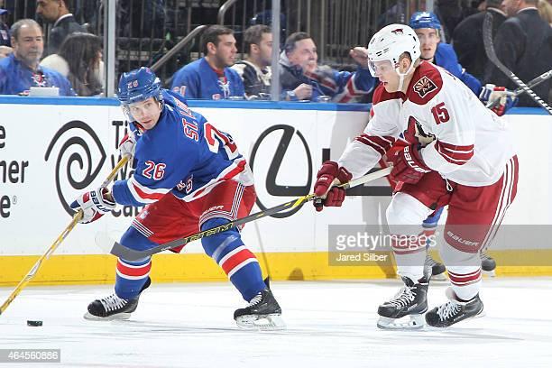 Henrik Samuelsson of the Arizona Coyotes skates against Martin St Louis of the New York Rangers at Madison Square Garden on February 26 2015 in New...