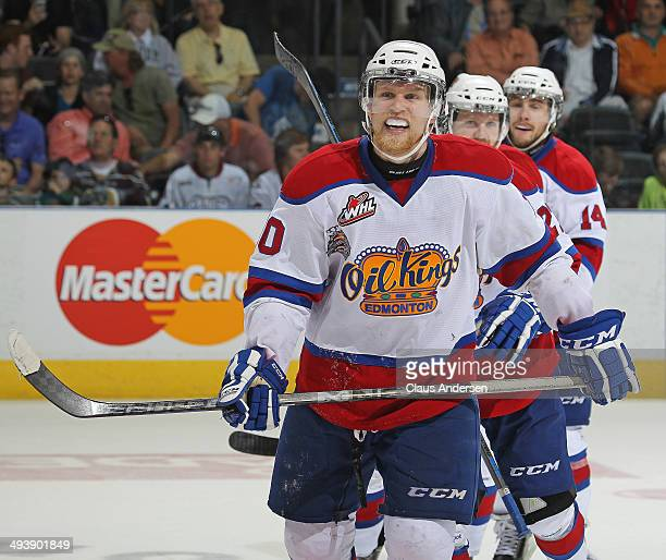 Henrik Samuelsson of the Edmonton Oil Kings skates back to the bench happy after securing the win with an empty net goal against the Guelph Storm in...