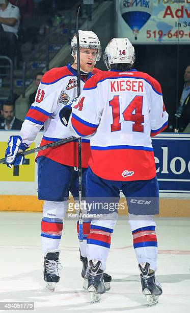 Henrik Samuelsson of the Edmonton Oil Kings talks over a play with teammate Riley Keiser prior to a faceoff against the Guelph Storm in the final of...