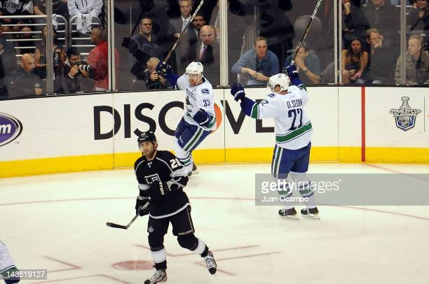 Henrik Sedin and Daniel Sedin of the Vancouver Canucks celebrate after a goal against the Los Angeles Kings in Game Four of the Western Conference...