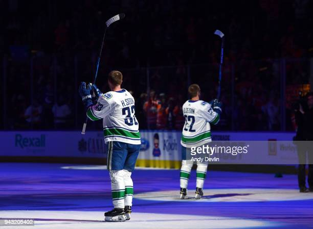 Henrik Sedin and Daniel Sedin of the Vancouver Canucks salute the crowed following the game against the Edmonton Oilers on April 7 2018 at Rogers...