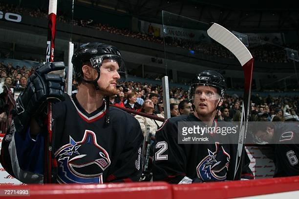 Henrik Sedin and Daniel Sedin of the Vancouver Canucks sit on the bench against the Detroit Red Wings at General Motors Place on November 14, 2006 in...