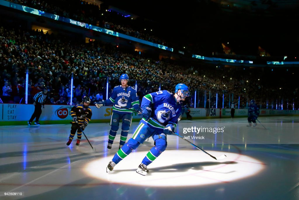 Henrik Sedin #33 and Daniel Sedin #22 of the Vancouver Canucks skate down the ice before their NHL game against the Arizona Coyotes at Rogers Arena April 5, 2018 in Vancouver, British Columbia, Canada. Vancouver won 4-3 in overtime.