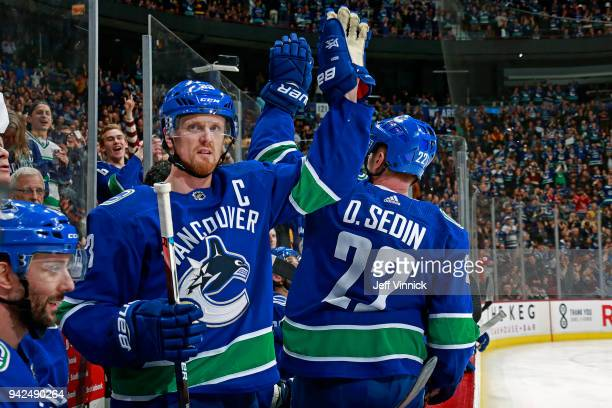 Henrik Sedin and Daniel Sedin of the Vancouver Canucks wave to fans after their NHL game against the Arizona Coyotes at Rogers Arena April 5 2018 in...