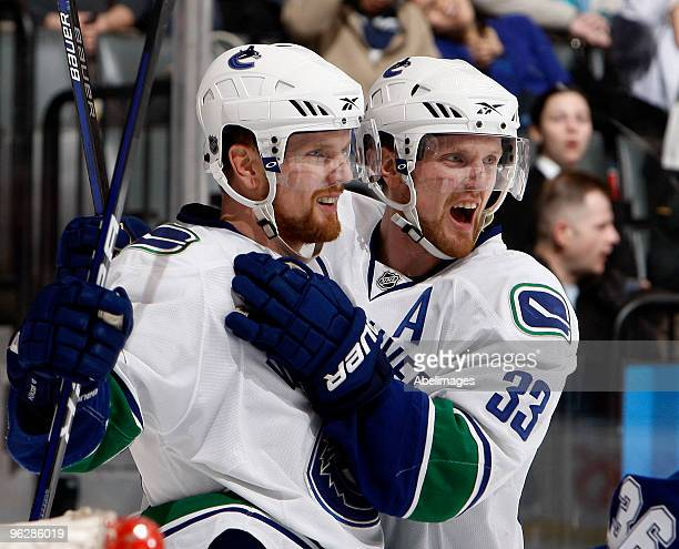 Henrik Sedin and Daniel Sedin the Vancouver Canucks celebrate goal during game action against the Toronto Maple Leafs January 30 2010 at the Air...