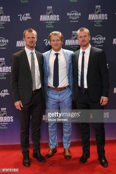 Henrik Sedin Brock Boeser and Daniel Sedin of the Vancouver Canucks arrive at the 2018 NHL Awards presented by Hulu at the Hard Rock Hotel Casino on...