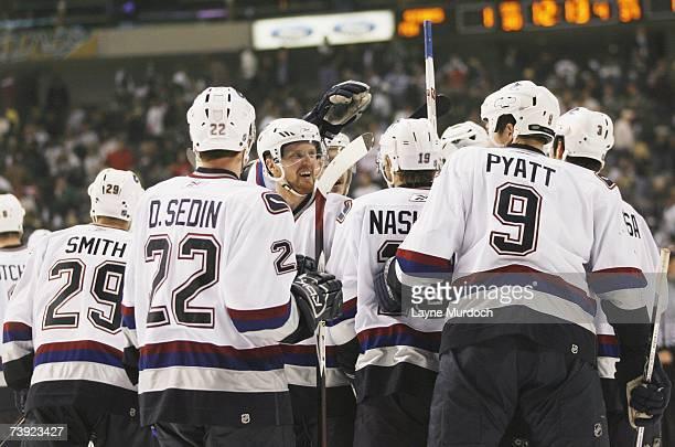 Henrik Sedin Daniel Sedin and Taylor Pyatt of the Vancouver Canucks celebrate against the Dallas Stars during game three of the 2007 NHL Western...