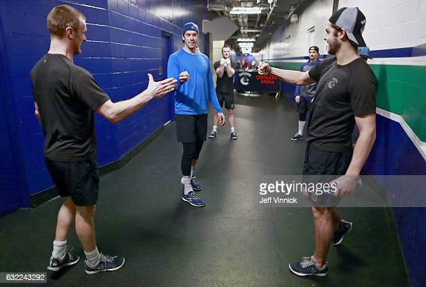 Henrik Sedin Jacob Markstrom and Michael Chaput of the Vancouver Canucks play rock paper scissors as they warm up before their NHL game against the...