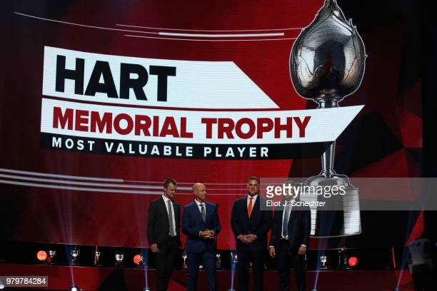 Henrik Sedin Mark Messier Eric Lindros and Alex Ovechkin of the Washington Capitals speak onstage to announce the nominees for the Hart Memorial...