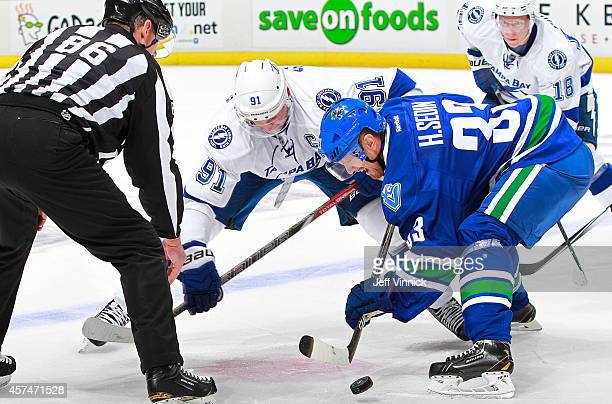 Henrik Sedin of the Vancouver Canucks and Steven Stamkos of the Tampa Bay Lightning face-off during their NHL game at Rogers Arena October 18, 2014...