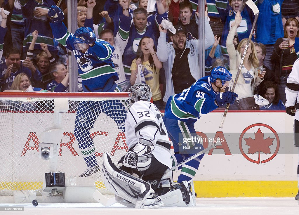 Henrik Sedin #33 of the Vancouver Canucks celebrate with Daniel Sedin #22 after Henrik scored on goalie Jonathan Quick #32 of the Los Angeles Kings during the first period in Game Five of the Western Conference Quarterfinals during the 2012 NHL Stanley Cup Playoffs at Rogers Arena on April 22, 2012 in Vancouver, British Columbia, Canada.