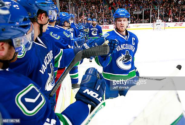 Henrik Sedin of the Vancouver Canucks celebrates a goal and his 900th NHL point during their NHL game against the San Jose Sharks at Rogers Arena...