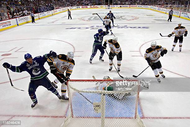 Henrik Sedin of the Vancouver Canucks celebrates after Daniel Sedin scored a goal in the third period against Tim Thomas of the Boston Bruins during...