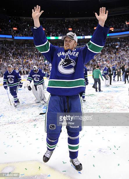 Henrik Sedin of the Vancouver Canucks celebrates after defeating the San Jose Sharks 32 in doubleovertime in Game Five to win the Western Conference...