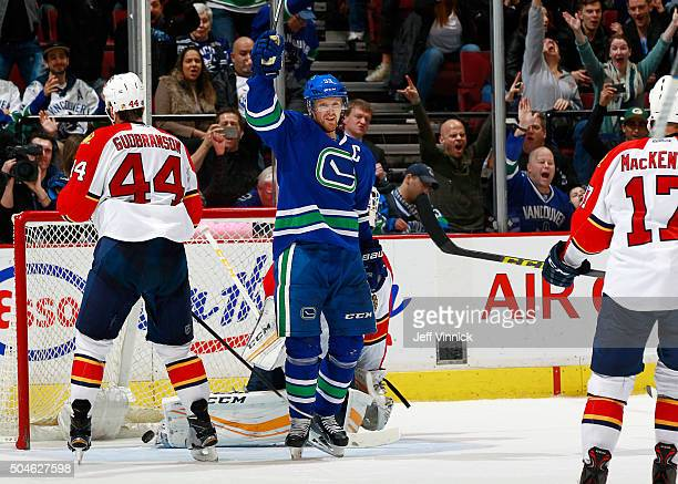 Henrik Sedin of the Vancouver Canucks celebrates after scoring in overtime on Roberto Luongo of the Florida Panthers as Erik Gudbranson of the...