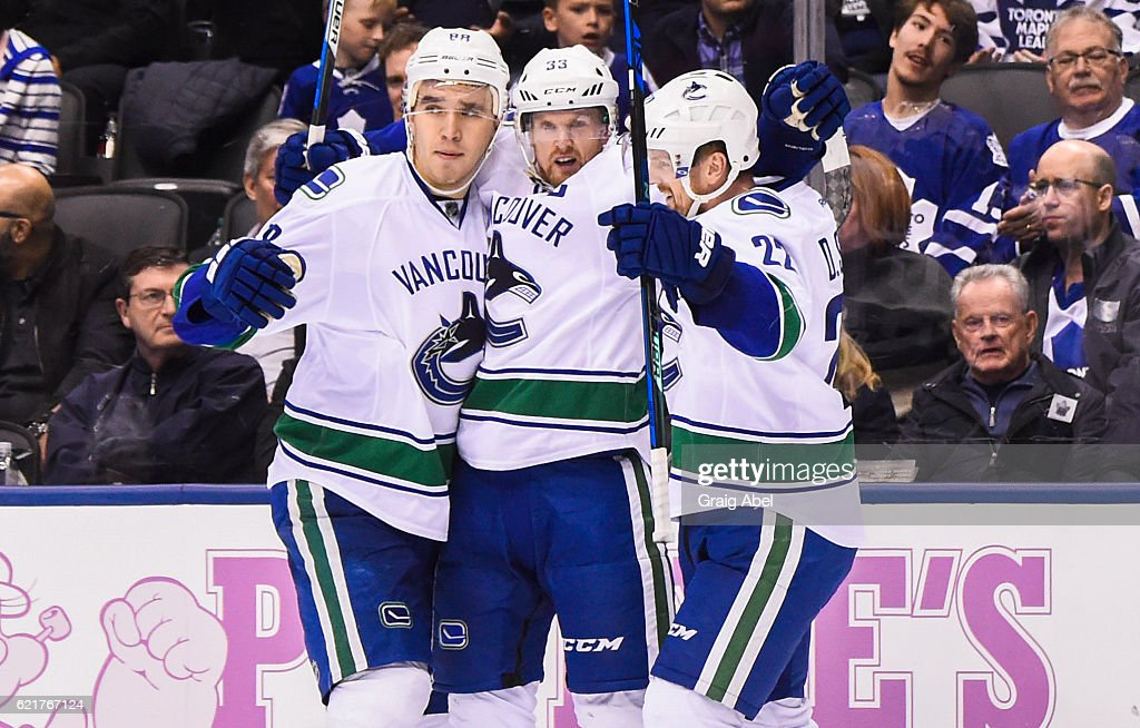 Henrik Sedin #33 of the Vancouver Canucks celebrates his goal with teammates Daniel Sedin #22 and Nikita Tryamkin #88 against the Toronto Maple Leafs during the second period at the Air Canada Centre on November 5, 2016 in Toronto, Ontario, Canada.