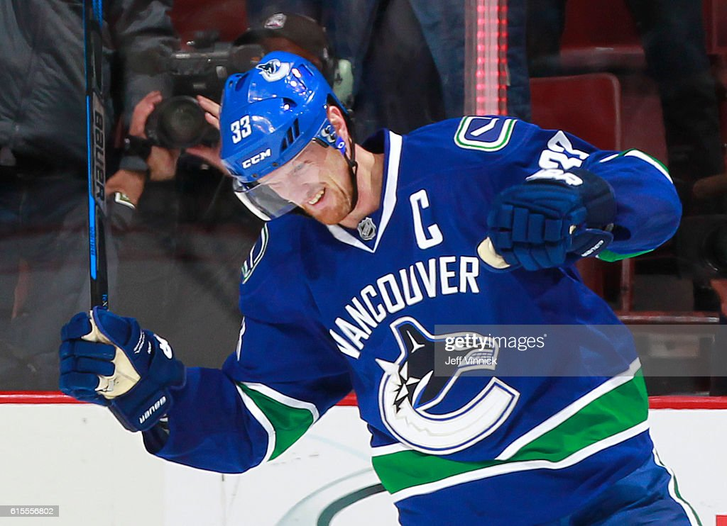 Henrik Sedin #33 of the Vancouver Canucks celebrates the overtime winning goal against the St. Louis Blues during their NHL game at Rogers Arena October 18, 2016 in Vancouver, British Columbia, Canada. Vancouver won 2-1 in overtime.