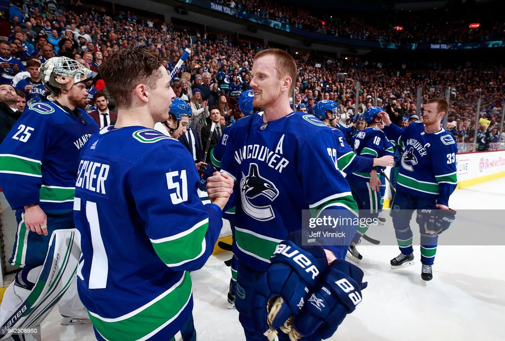 Henrik Sedin #33 of the Vancouver Canucks congratulates Troy Stecher #51after their NHL game against the Arizona Coyotes at Rogers Arena April 5, 2018 in Vancouver, British Columbia, Canada.