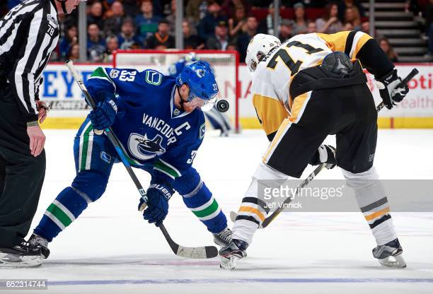 Henrik Sedin of the Vancouver Canucks faces off against Evgeni Malkin of the Pittsburgh Penguins during their NHL game at Rogers Arena March 11, 2017...