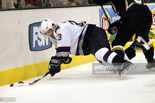 Henrik Sedin of the Vancouver Canucks fights for the puck against Darryl Sydor of the Dallas Stars during the 2nd period of game three of the 2007...