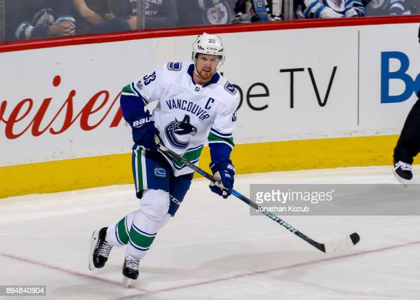 Henrik Sedin of the Vancouver Canucks follows the play up the ice during second period action against the Winnipeg Jets at the Bell MTS Place on...