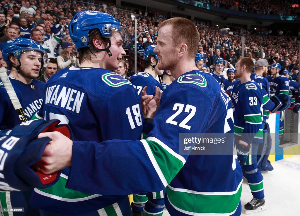 Henrik Sedin #33 of the Vancouver Canucks hugs Jake Virtanen #18 after their NHL game against the Arizona Coyotes at Rogers Arena April 5, 2018 in Vancouver, British Columbia, Canada.