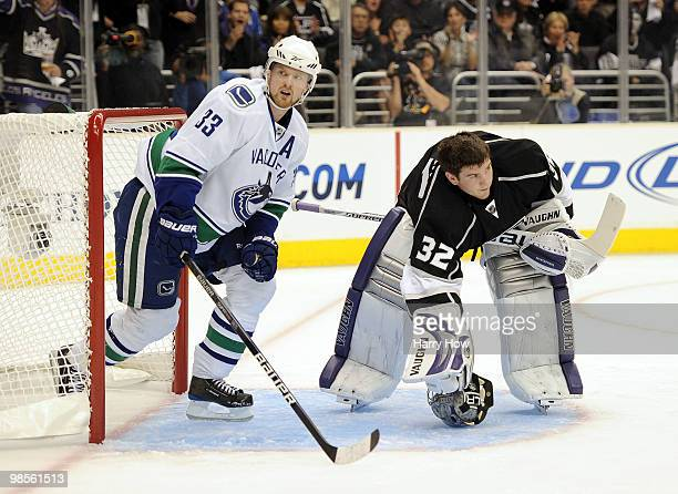 Henrik Sedin of the Vancouver Canucks leaves the net in front of Jonathan Quick of the Los Angeles Kings during the first period in game three of the...