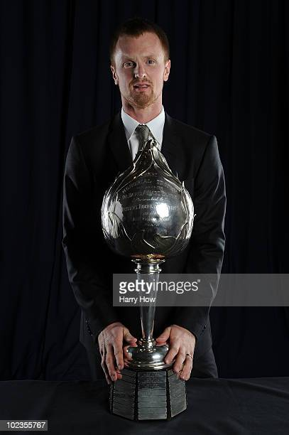 Henrik Sedin of the Vancouver Canucks poses for a portrait with the Hart Memorial Trophy during the 2010 NHL Awards at the Palms Casino Resort on...