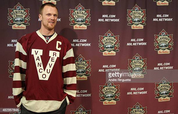 Henrik Sedin of the Vancouver Canucks poses with his NHL Heritage Classic jersey during the official unveiling at Canadian Tire Centre on November 28...