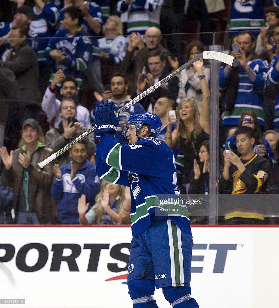 Henrik Sedin #33 of the Vancouver Canucks salutes the crowd after becoming the all-time franchise scoring leader after collecting an assist on a goal against the Dallas Stars during the second period in NHL action on February 15, 2013 at Rogers Arena in Vancouver, British Columbia, Canada.