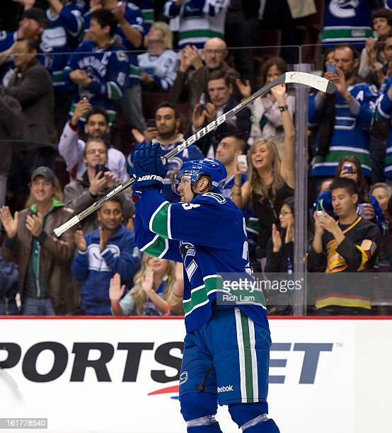 Henrik Sedin of the Vancouver Canucks salutes the crowd after becoming the alltime franchise scoring leader after collecting an assist on a goal...
