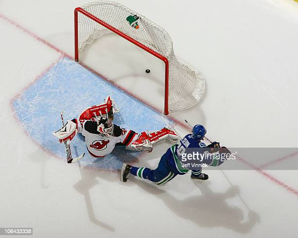 Henrik Sedin of the Vancouver Canucks scores on a penalty shot against Martin Brodeur of the New Jersey Devils during their game at Rogers Arena on...
