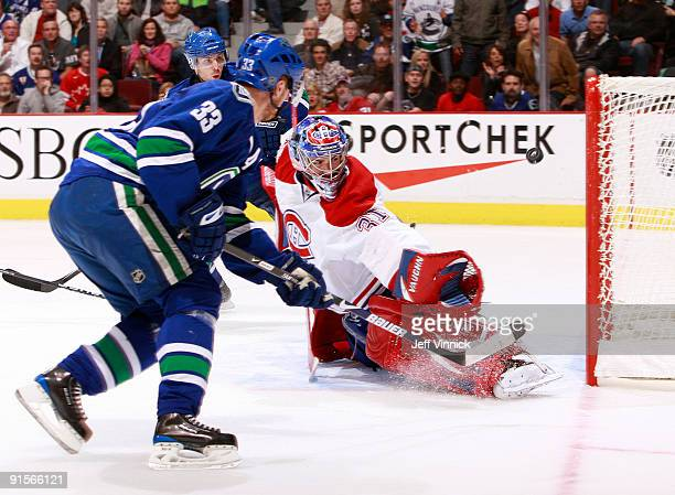 Henrik Sedin of the Vancouver Canucks shoots the puck past Carey Price of the Montreal Canadiens for Vancouver's fifth goal during their game at...
