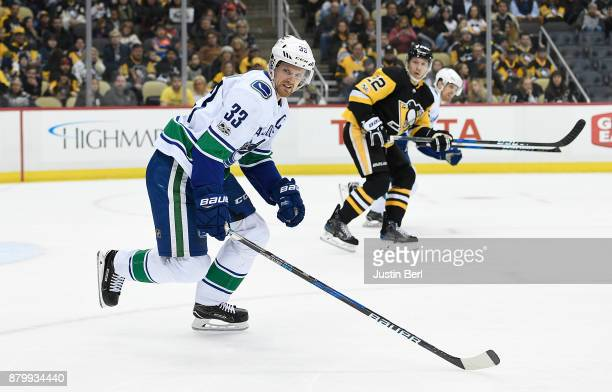 Henrik Sedin of the Vancouver Canucks skates in the first period during the game against the Pittsburgh Penguins at PPG PAINTS Arena on November 22...