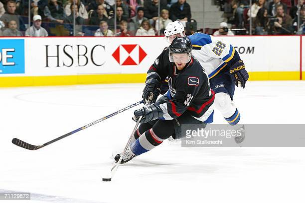 Henrik Sedin of the Vancouver Canucks skates with the puck against the St. Louis Blues at General Motors Place on February 8, 2006 in Vancouver,...