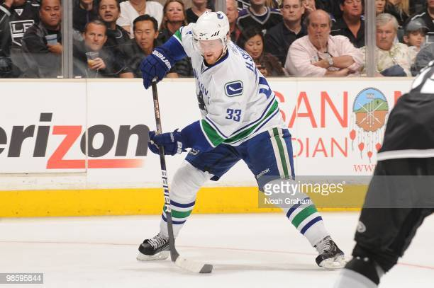 Henrik Sedin of the Vancouver Canucks skates with the puck against the Los Angeles Kings in Game Three of the Western Conference Quarterfinals during...
