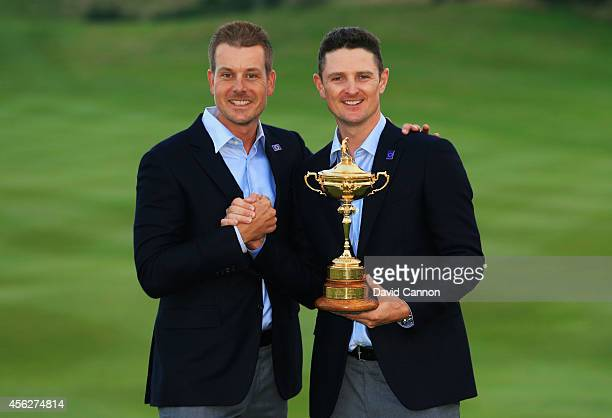 Henrik Stenson and Justin Rose of Europe pose with the Ryder Cup trophy after the Singles Matches of the 2014 Ryder Cup on the PGA Centenary course...