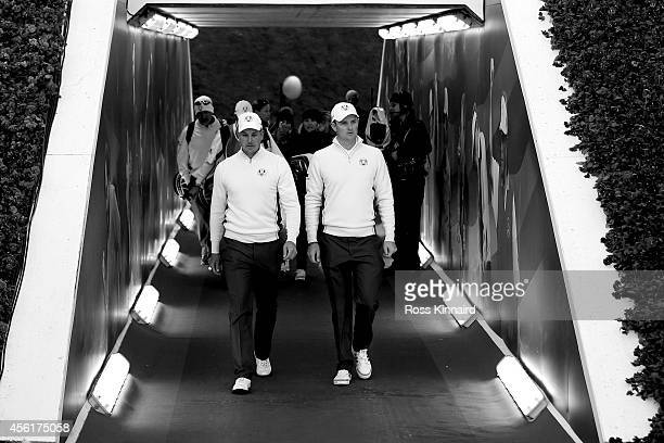 Henrik Stenson and Justin Rose of Europe walk to the 1st tee prior to the Morning Fourballs of the 2014 Ryder Cup on the PGA Centenary course at the...