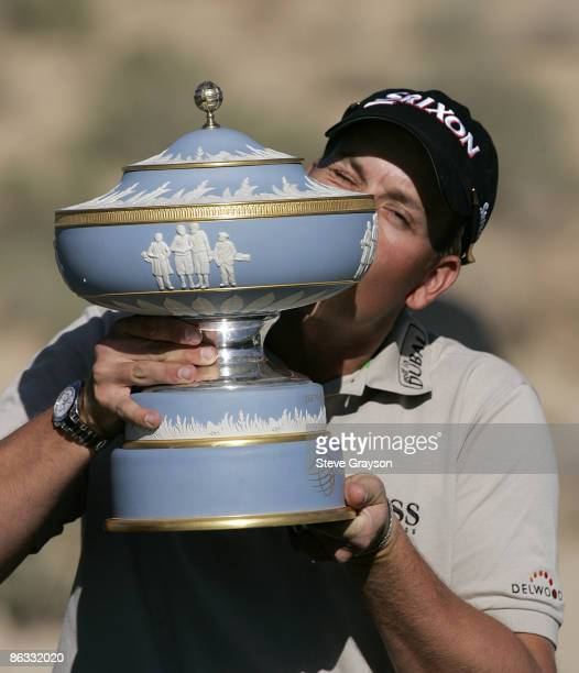 Henrik Stenson kisses the Walter Hagen Trophy after his win over Geoff Ogilvy in the Championship round match of the WGCAccenture Match Play...