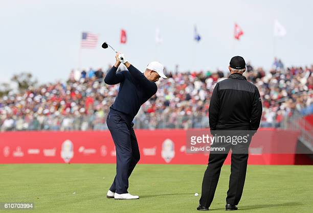 Henrik Stenson of Europe plays a shot as coach Pete Cowen looks on during practice prior to the 2016 Ryder Cup at Hazeltine National Golf Club on...