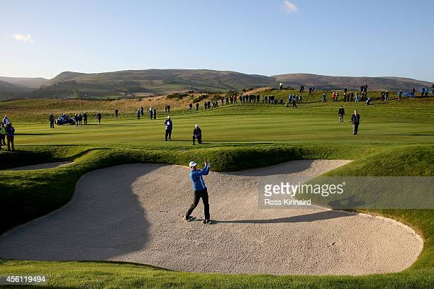 Henrik Stenson of Europe plays from a bunker on the 3rd hole during the Morning Fourballs of the 2014 Ryder Cup on the PGA Centenary course at the...