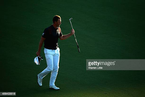Henrik Stenson of Sweden acknowledges the crowd on the 18th green during the third round of the DP World Tour Championship at Jumeirah Golf Estates...