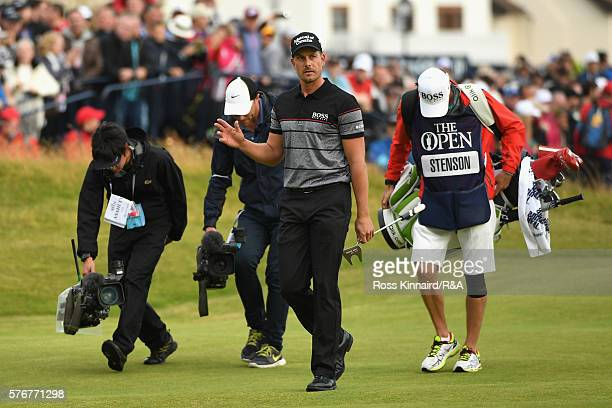 Henrik Stenson of Sweden acknowledges the crowd on the 18th hole during the final round on day four of the 145th Open Championship at Royal Troon on...